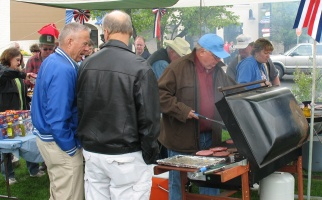 Picture of people grilling burgers
